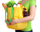 Girl with shopping bag isolated on white — Stock Photo
