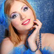Portrait of beautiful young woman with glamour make up, on blue background — Foto de Stock