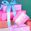Various gift boxes on a colorful background — Stock Photo