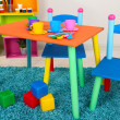 Small and colorful table and chairs for little kids — Stock Photo #25093617