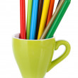 Colorful pencils in cup isolated on white — Stockfoto