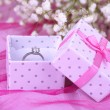 Engagement ring on pink cloth — Stock Photo #25094265