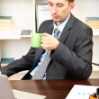 Stock Photo: Young businessmat lunch break in office