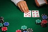 Poker setting on green table — Stock Photo