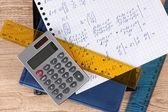 Math on copybook page closeup — Stock Photo