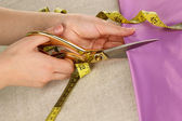 Seamstress cut green fabric close-up — Stock Photo