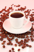 Cup of strong coffee on pink background — Stock Photo