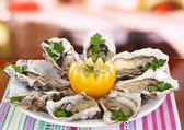 Oysters on table in cafe — Stock Photo