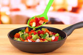 Vegetable ragout in pan, on wooden table on bright background — Stock Photo