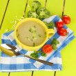 Diet soup with vegetables in cup on green wooden table close-up — Stock Photo #25187837