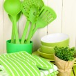 Stock Photo: Kitchen settings: utensil, potholders, towels and else on wooden table