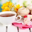 Beautiful composition with cup of tea and marshmallow on wooden picnic table on natural background — Stock Photo #25188321
