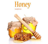 Two jars of honey and honeycombs isolated on white — Stock Photo