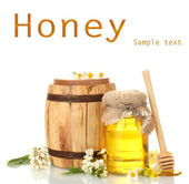 Honey in bank and barrel isolated on white — Stock Photo