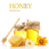 Jars of honey and honeycombs isolated on white — Stock Photo
