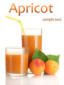 Two glasses of apricot juice and apricots with leaf isolated on white — Stock Photo