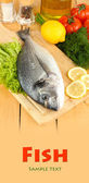 Fresh dorado on chopping board with lemon and vegetables on wooden table — Stock Photo