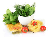 Composition of mortar, pasta and green herbals, isolated on white — Stock Photo