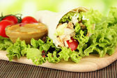 Kebab - grilled meat and vegetables, on bamboo mat, on bright background — Stok fotoğraf