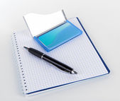 Blue business card holder, notebook and pen isolated on white — Stock Photo