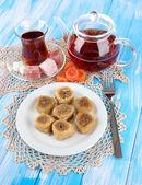 Sweet baklava on plate with tea on table — Stock Photo