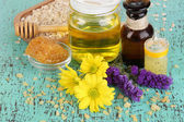 Fragrant honey spa with oils and honey on wooden table close-up — Stock Photo