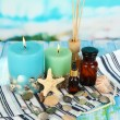 Sea spa composition on wooden table on blue natural background — Stock Photo