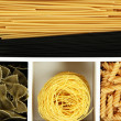 Different types of pasta in white wooden box sections close-up — Stock Photo #25314905