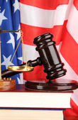 Judge gavel and books on american flag background — Stock Photo
