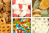 Multicolor candies and cookies in white wooden box close up — Stock Photo