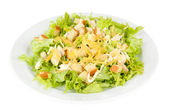 Caesar salad on white plate, isolated on white — Stockfoto