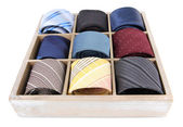 Neckties in wooden box isolated on white — Stock Photo