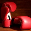 Boxing gloves on wooden background — Stock Photo #25325363