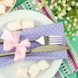 Table setting in violet and white tones on color wooden background — Stock Photo #25325397