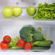 Open refrigerator with vegetarian (diet) food — Foto de stock #25325533
