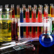 Colorful test tubes on dark background - Photo