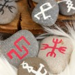 Stock Photo: Fortune telling with symbols on stones on white fur background