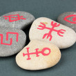 Stock Photo: Fortune telling with symbols on stones on grey background