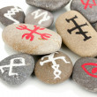Stock Photo: Fortune telling with symbols on stones isolated on white