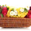 Beautiful spring flowers in basket isolated on white - Stock Photo