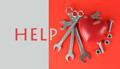 Reconstruction of heart tools on color background — Stock Photo