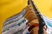 Men's shirts on hangers on yellow background — Stock Photo