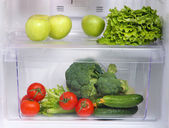 Open refrigerator with vegetarian (diet) food — Stock Photo