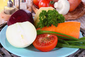 Peeled vegetables on plate on napkin close-up — Stock Photo