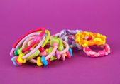 Scrunchies on a pink background — Stock Photo