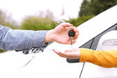 Woman and man hands with car key, close up — Stock Photo