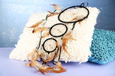 Beautiful dream catcher and pillows on blue background — Stok fotoğraf