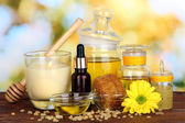 Fragrant honey spa with oils and honey on wooden table on natural background — Stock Photo