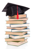 Grad hat with books isolated on white — Stok fotoğraf