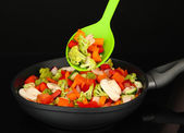 Vegetable ragout in pan, isolated on black — Stock fotografie